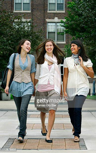 Shawnee Mission East students Sami Rebein, Allie Fields and Legna Cedillo wear fall's key pieces: skinny jeans , halter vest , tie-back blouse and...