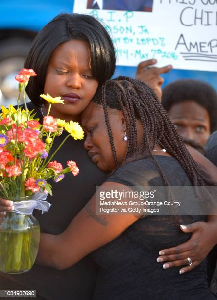 Shawnese Armstrong left and Alice Corley the sister and mother of Lionel Gibson console each other during a vigil for Gibson in Long Beach CA on...