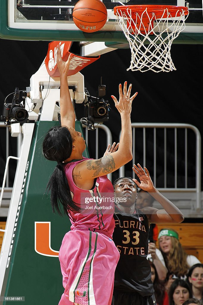 Shawnice Wilson #40 of the Miami Hurricanes goes to the basket over Natasha Howard #33 of the Florida State Seminoles on February 10, 2013 at the BankUnited Center in Coral Gables, Florida. The Seminoles defeated the Hurricanes 93-78.