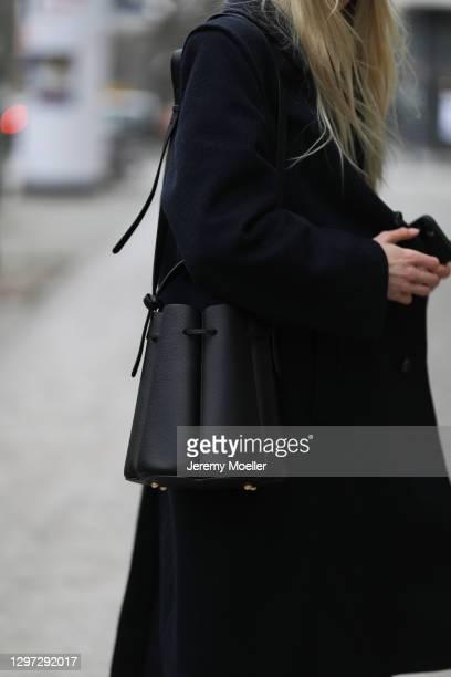 Shawny Sander wearing vintage coat, Filippa K sweater and Polene Paris bag on January 18, 2021 in Berlin, Germany.