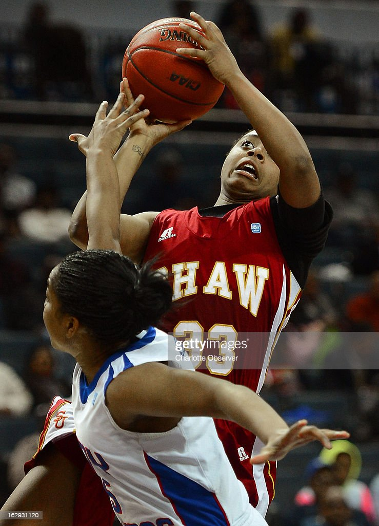 Shaw's Crystal Wilson (33) keeps her eye on the basket as she drives against Elizabeth City State's Derricka Henry during the CIAA tournament semifinals on Friday, March 1, 2013, at Time Warner Cable Arena in Charlotte, North Carolina. Shaw advanced, 76-61.