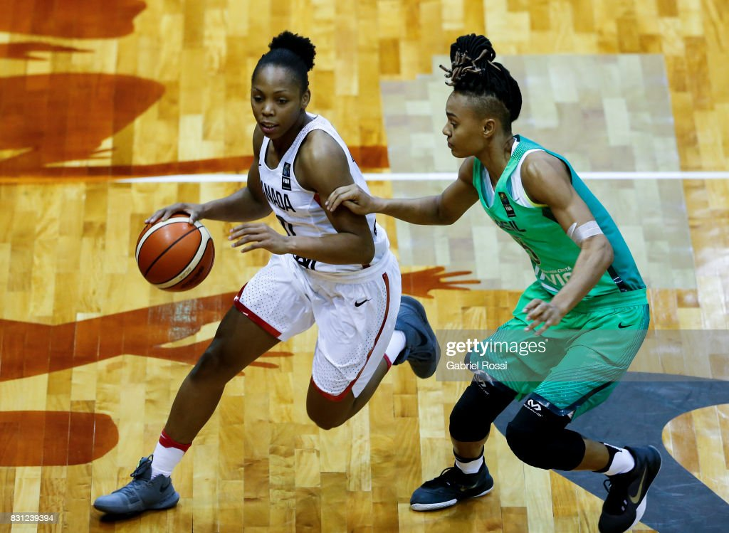 Shay Colley of Canada (L) fights for the ball with Raphaella Monteiro Da Silva of Brazil during a match between Canada and Brazil as part of the FIBA Women's AmeriCup Semi Final at Obras Sanitarias Stadium on August 12, 2017 in Buenos Aires, Argentina.