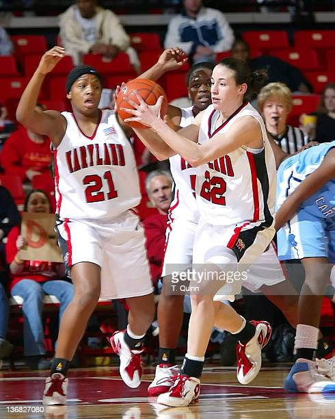 Shay Doron clutches the ball in front of Ashleigh Newman during a game at Comcast Center in College Park, MAryland on January 9, 2005.