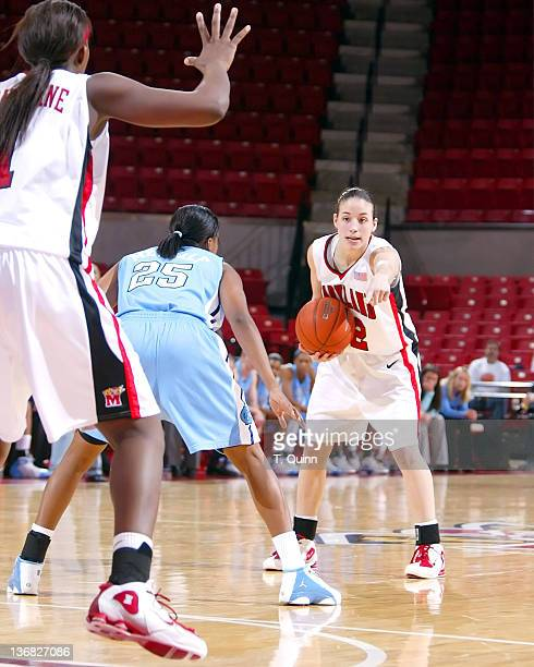 Shay Doron points to where she wants teammate Crystal Langhorne to go. #25 Leah Metcalfe is hoping to intercept during a game at Comcast Center in...