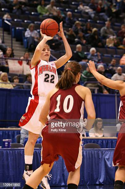 Shay Doron with a jumper over Niki Finelli of Harvard during the NCAA Women's Basketball Tournament first round matchup between the Harvard Crimson...