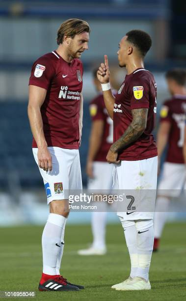 Shay Facey of Northampton Town makes a point to team mate Ash Taylor during the Carabao Cup First Round match between Wycombe Wanderers and...
