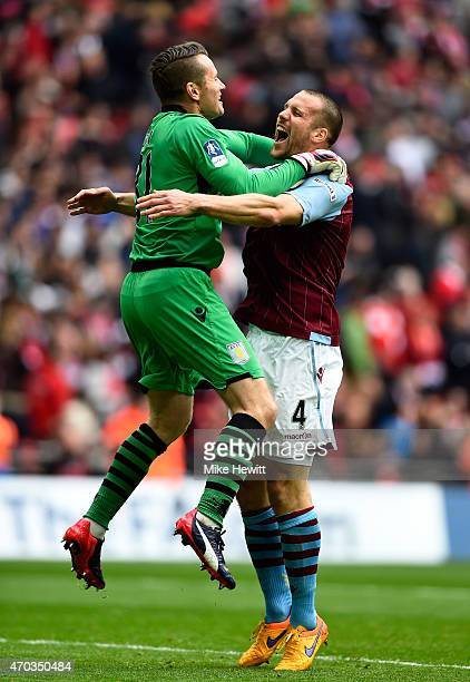 Shay Given and Ron Vlaar of Aston Villa celebrate victory after the FA Cup Semi Final between Aston Villa and Liverpool at Wembley Stadium on April...