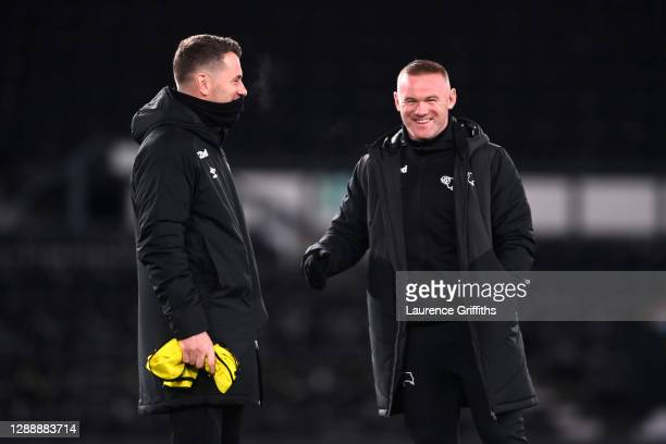 Shay Given, Co-Interim Manager of Derby County speaks with Wayne Rooney, Co-Interim Manager of Derby County prior to the Sky Bet Championship match...