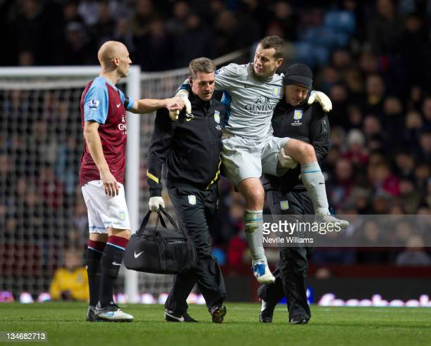 Shay Given of Aston Villa carried off with a concerned James Collins looks on during the Barclays Premier League match between Aston Villa and...