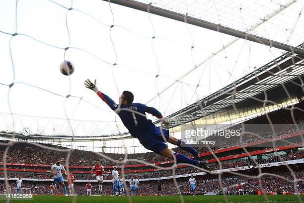 Shay Given of Aston Villa fails to stop Mikel Arteta of Arsenal's free kick during the Barclays Premier League match between Arsenal and Aston Villal...