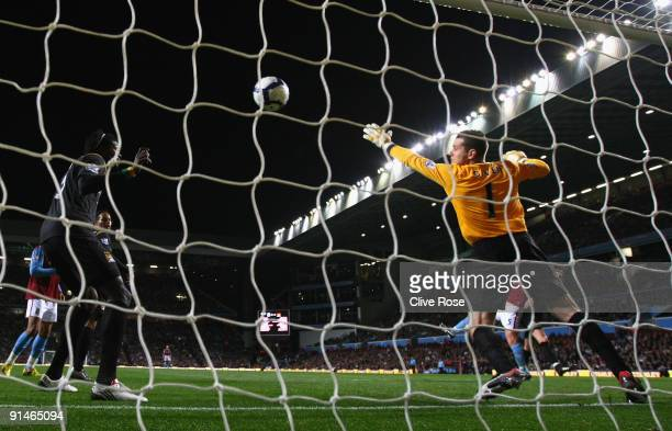 Shay Given of Manchester City is unable to stop Richard Dunne of Aston Villa scoring the opening goal during the Barclays Premier League match...