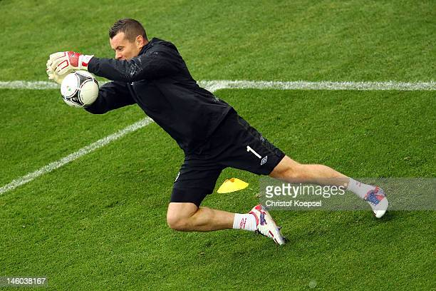 Shay Given of Republic of Ireland saves a ball during a Republic of Ireland training session prior to the UEFA EURO 2012 Group C match against...