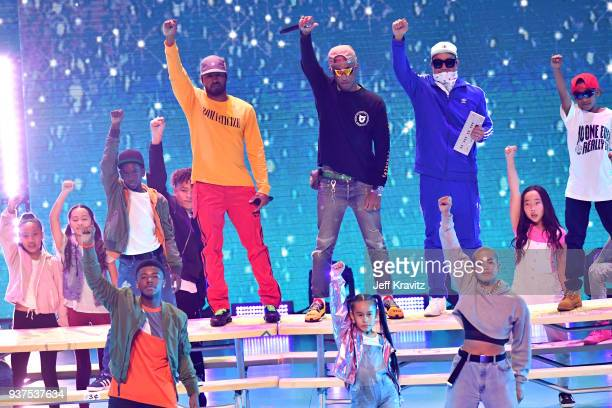 Shay Haley Pharrell Williams and Chad Hugo of music group NERD perform onstage at Nickelodeon's 2018 Kids' Choice Awards at The Forum on March 24...
