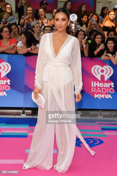 Shay Mitchell arrives at the 2017 iHeartRADIO MuchMusic Video Awards at MuchMusic HQ on June 18 2017 in Toronto Canada