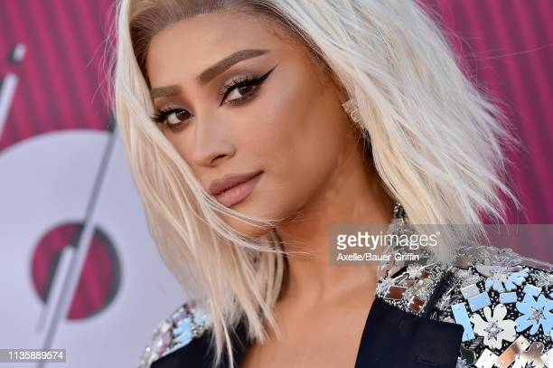 Shay Mitchell arrives at the 2019 iHeartRadio Music Awards which broadcasted live on FOX at Microsoft Theater on March 14 2019 in Los Angeles...
