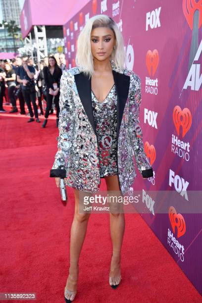 Shay Mitchell attends the 2019 iHeartRadio Music Awards which broadcasted live on FOX at Microsoft Theater on March 14 2019 in Los Angeles California