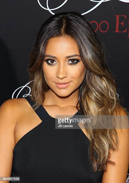 Shay Mitchell attends the 'Pretty Little Liars' Celebrates 100 Episodes held at the W Hollywood Hotel on May 31 2014 in Hollywood California