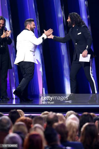 Shay Mooney and Dan Smyers of Dan Shay accept an award onstage during the 53rd annual CMA Awards at the Music City Center on November 13 2019 in...