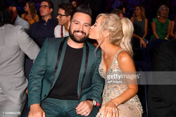 Shay Mooney and Hannah Billingsley attend the 2019 CMT Music Awards at Bridgestone Arena on June 05 2019 in Nashville Tennessee