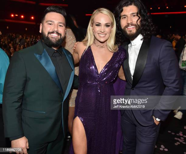 Shay Mooney of Dan Shay Carrie Underwood and Dan Smyers of Dan Shay attend the 2019 American Music Awards at Microsoft Theater on November 24 2019 in...