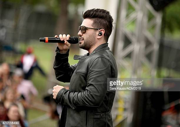 Shay Mooney of Dan Shay performs onstage during the ACM Party For A Cause Festival at Globe Life Park in Arlington on April 17 2015 in Arlington Texas