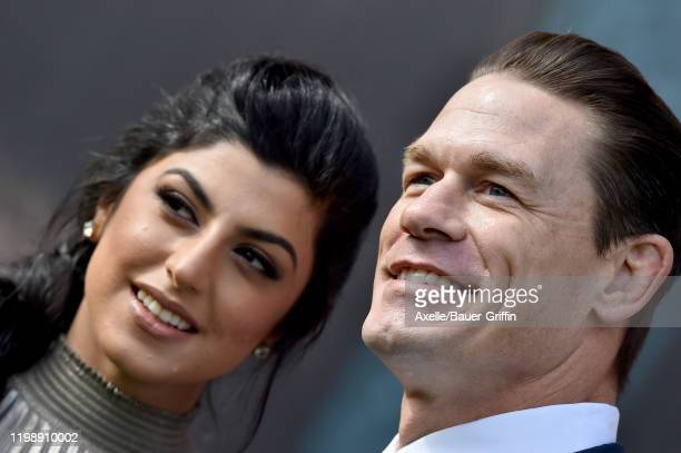 Shay Shariatzadeh and John Cena attend the premiere of Universal Pictures' Dolittle at Regency Village Theatre on January 11 2020 in Westwood...