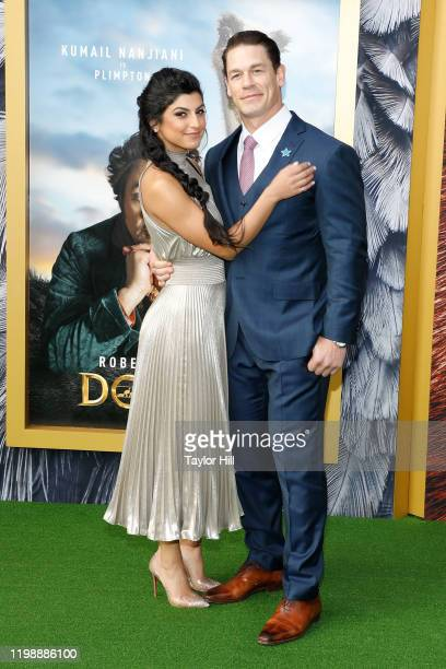 Shay Shariatzadeh and John Cena attend the world premiere of Dolittle at Regency Village Theatre on January 11 2020 in Westwood California