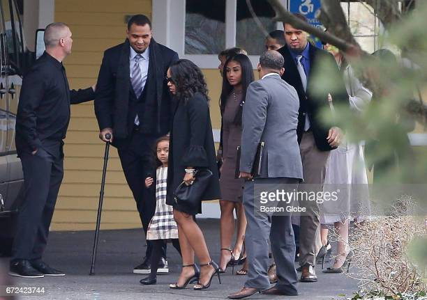 Shayanna JenkinsHernandez holds her daughter's hand as she walks into O'Brien Funeral Home for Aaron Hernandez's funeral in Bristol CT on Apr 24 2017...