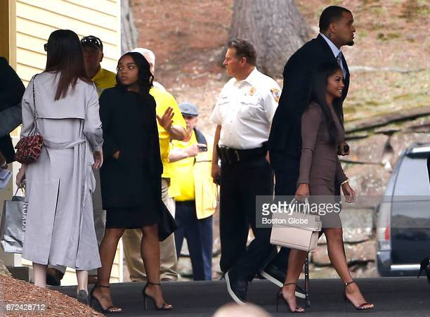 Shayanna JenkinsHernandez second from left walks out of O'Brien Funeral Home following Aaron Hernandez's funeral in Bristol CT on Apr 24 2017 Family...