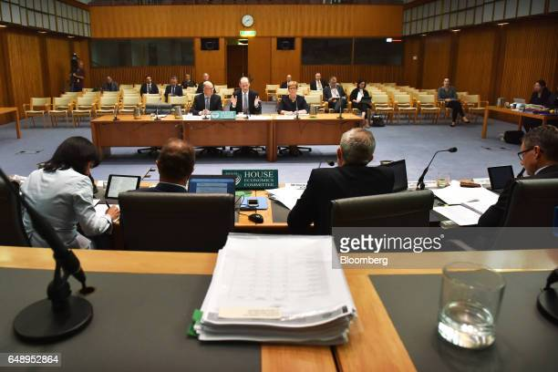 Shayne Elliott chief executive officer of Australia New Zealand Banking Group Ltd center attends a hearing before the House of Representatives...