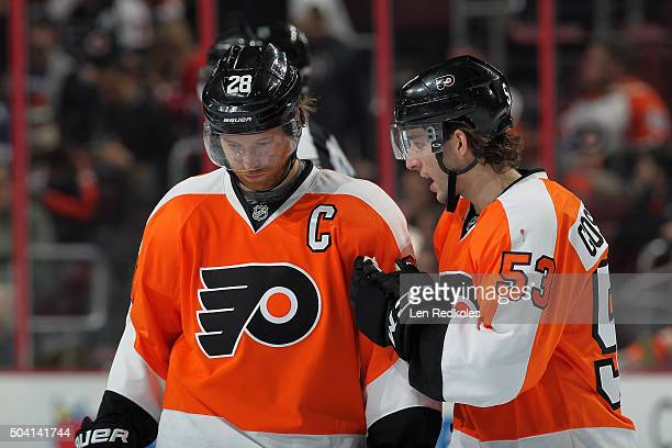 Shayne Gostisbehere and Claude Giroux of the Philadelphia Flyers chat during a stoppage in play against the Montreal Canadiens on January 5 2016 at...
