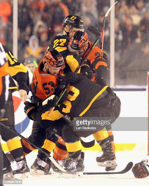 Shayne Gostisbehere and James van Riemsdyk of the Philadelphia Flyers scuffle with Nick Bjugstad and Kris Letang of the Pittsburgh Penguins at the...