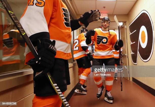 Shayne Gostisbehere and Jori Lehtera of the Philadelphia Flyers prepare for warm-ups outside the locker room prior to playing the New York Rangers on...
