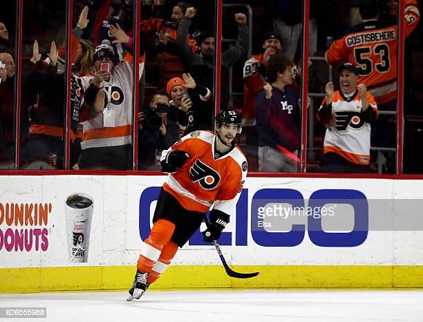 Shayne Gostisbehere of the Philadelphia Flyers celebrates his game winning goal during the overtime shootout against the Boston Bruins on November 29...