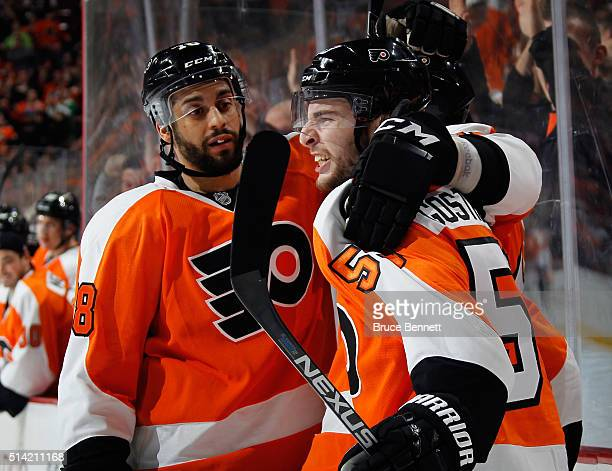 Shayne Gostisbehere of the Philadelphia Flyers celebrates his goal at 1651 of the second period against the Tampa Bay Lightning and is joined by...