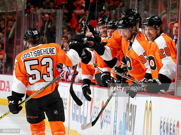 Shayne Gostisbehere of the Philadelphia Flyers celebrates his goal with teammates on the bench in the second period against the Montreal Canadiens at...