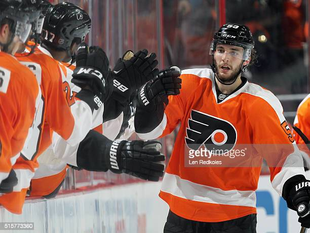 Shayne Gostisbehere of the Philadelphia Flyers celebrates his second period goal against the Detroit Red Wings with his teammates on the bench on...