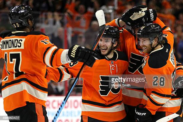 Shayne Gostisbehere of the Philadelphia Flyers celebrates with teammates after scoring the gamewinning goal in overtime against the Nashville...