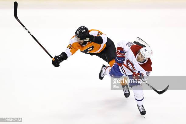Shayne Gostisbehere of the Philadelphia Flyers collides with Artturi Lehkonen of the Montreal Canadiens during the second period in Game Two of the...
