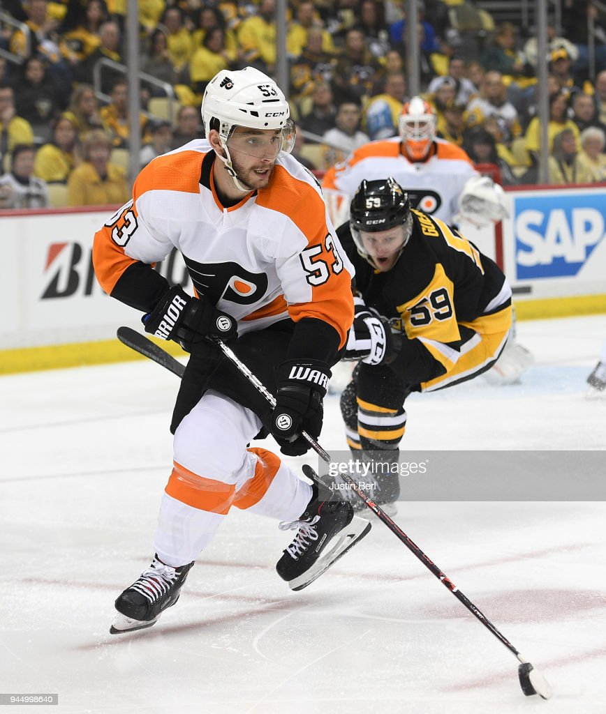Shayne Gostisbehere #53 of the Philadelphia Flyers handles the puck under pressure from Jake Guentzel #59 of the Pittsburgh Penguins during the second period in Game One of the Eastern Conference First Round during the 2018 NHL Stanley Cup Playoffs at PPG PAINTS Arena on April 11, 2018 in Pittsburgh, Pennsylvania.