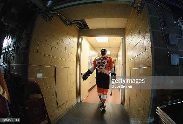 Shayne Gostisbehere of the Philadelphia Flyers heads back to the lockerroom folowing warmups prior to the game against the Nashville Predators at the...