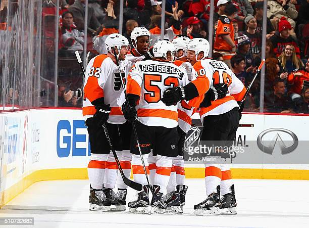 Shayne Gostisbehere of the Philadelphia Flyers is congratulated by his teammates after scoring a firstperiod goal against the New Jersey Devils...