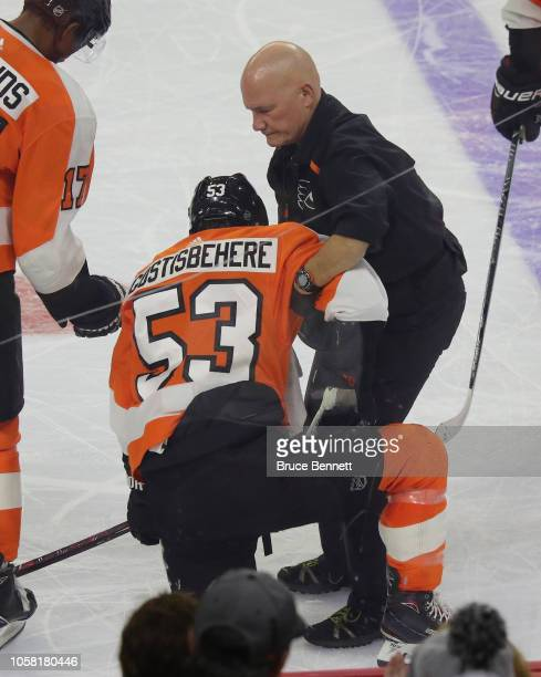 Shayne Gostisbehere of the Philadelphia Flyers is taken off the ice after a third period injury against the Colorado Avalanche at the Wells Fargo...