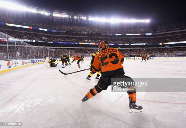 Shayne Gostisbehere of the Philadelphia Flyers makes a pass play during the 2019 Coors Light NHL Stadium Series game between the Pittsburgh Penguins...