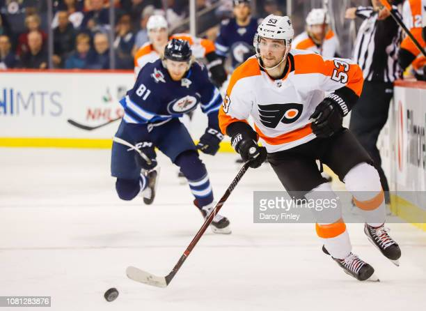 Shayne Gostisbehere of the Philadelphia Flyers plays the puck down the ice during second period action against the Winnipeg Jets at the Bell MTS...