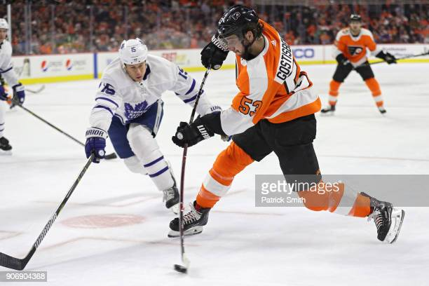 Shayne Gostisbehere of the Philadelphia Flyers shoots in front of Matt Martin of the Toronto Maple Leafs during the second period at Wells Fargo...