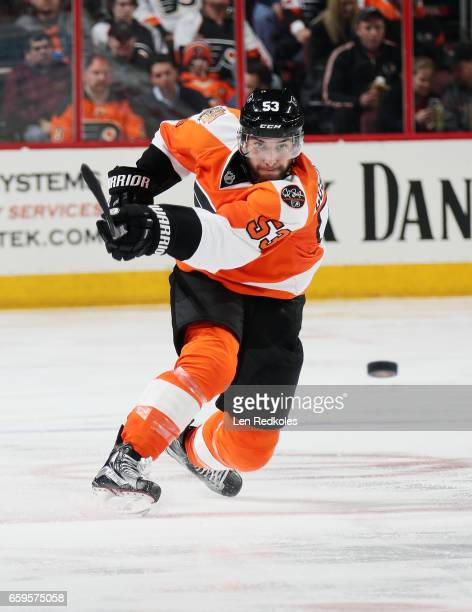 Shayne Gostisbehere of the Philadelphia Flyers shoots the puck into the corner against the Ottawa Senators on March 28 2017 at the Wells Fargo Center...