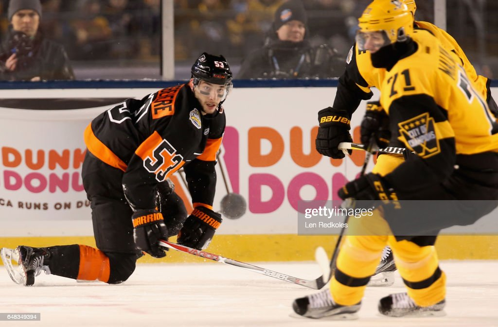 Shayne Gostisbehere #53 of the Philadelphia Flyers skates back on defense against Evgeni Malkin #71 of the Pittsburgh Penguins in the first period of the 2017 Coors Light NHL Stadium Series at Heinz Field on February 25, 2017 in Pittsburgh, Pennsylvania.