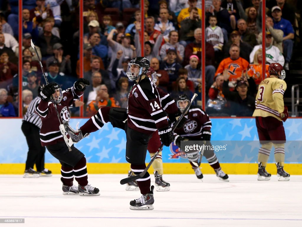 Shayne Gostisbehere #14 of the Union College Dutchmen celebrates teammate's Daniel Ciampini's goal in the third period against the Boston College Eagles during the 2014 NCAA Division I Men's Hockey Championship Semifinal at Wells Fargo Center on April 10, 2014 in Philadelphia, Pennsylvania.