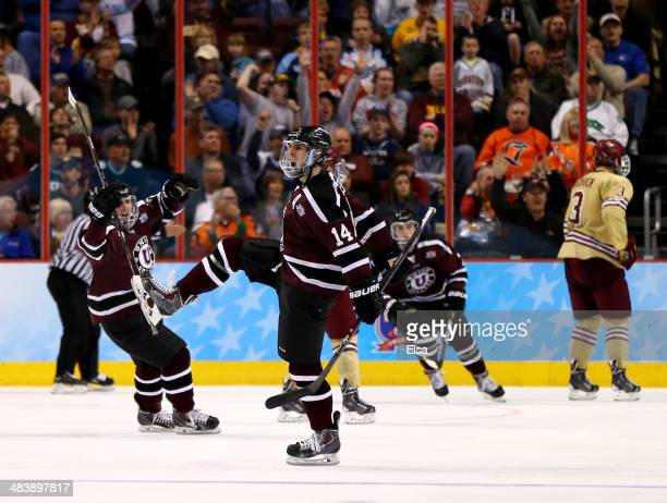 Shayne Gostisbehere of the Union College Dutchmen celebrates teammate's Daniel Ciampini's goal in the third period against the Boston College Eagles...